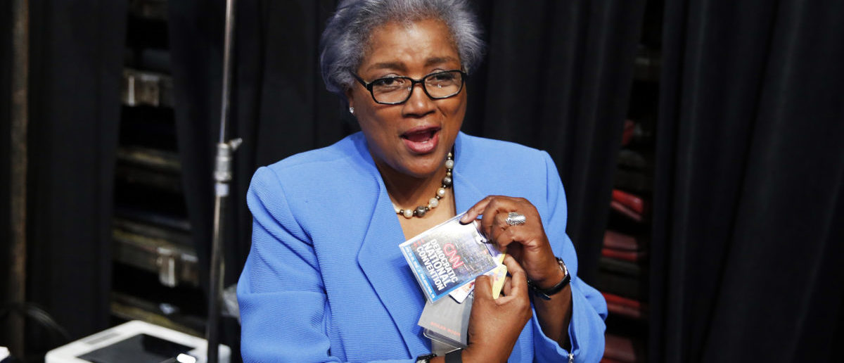 Acting DNC Chair Donna Brazile removes her CNN credential so she may participate in the Democratic National Convention in Philadelphia, Pennsylvania, U.S. July 25, 2016. REUTERS/Lucy Nicholson - HT1EC7P1O1XAO