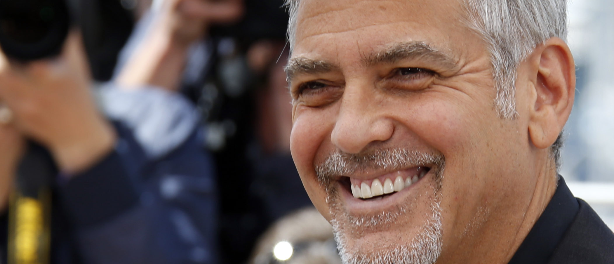 "Cast member George Clooney poses during a photocall for the film ""Money Monster"" out of competition at the 69th Cannes Film Festival in Cannes, France, May 12, 2016. REUTERS/Jean-Paul Pelissier - LR1EC5C10A8JE"