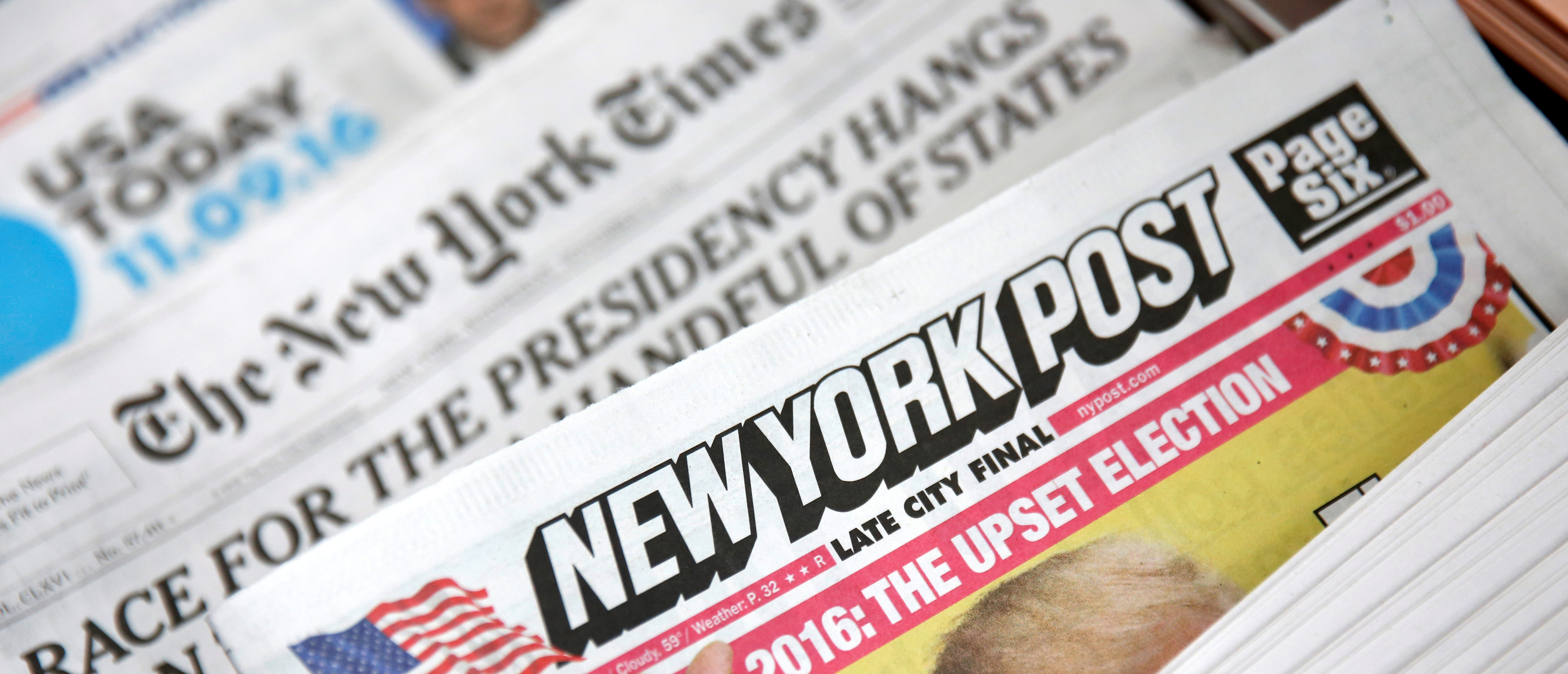 The cover of the New York Post newspaper is seen with other papers at a newsstand in New York U.S., November 9, 2016. REUTERS/Shannon Stapleton - S1AEULWGJQAB