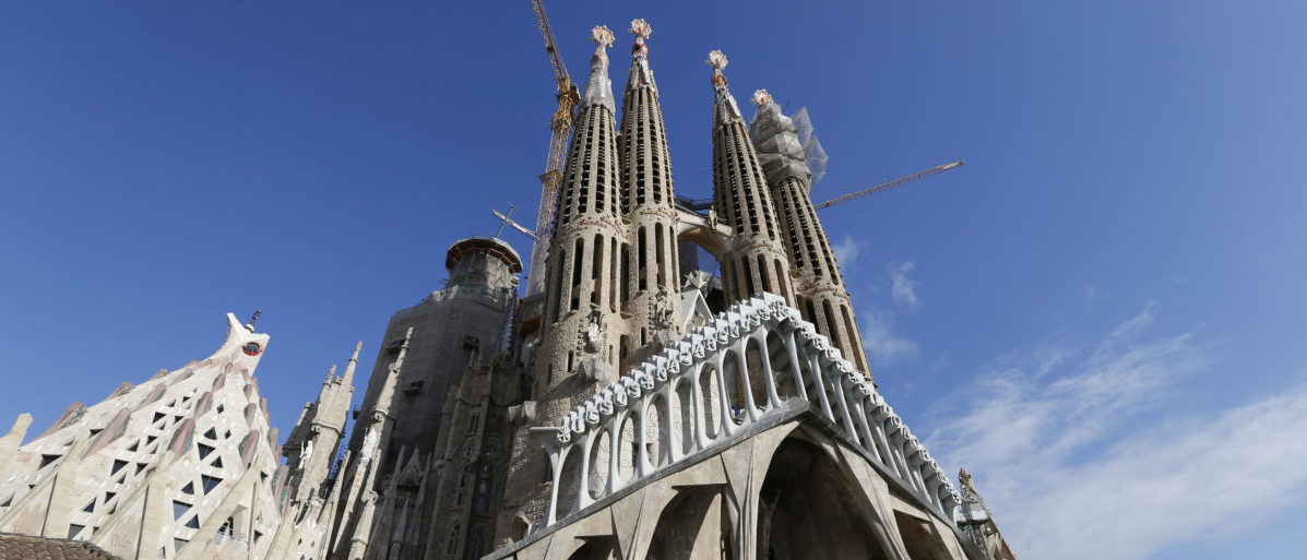 Towers and construction cranes are seen as work continues on the Basilica Sagrada Familia, which was designed by Antoni Gaudi in Barcelona, Spain, December 30, 2016. REUTERS/Regis Duvignau - LR1ED121EDB6X