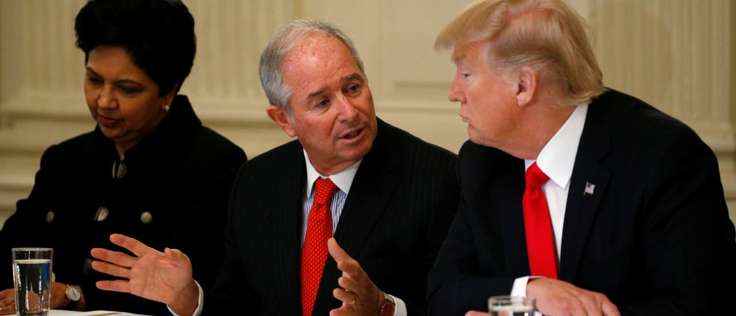 Blackstone CEO Stephen Schwarzman (C) speaks to U.S. President Donald Trump during Trump's strategy and policy forum with chief executives of major U.S. companies at the White House in Washington, U.S. February 3, 2017. At left is Pepsico CEO Indra Nooyi. REUTERS/Kevin Lamarque