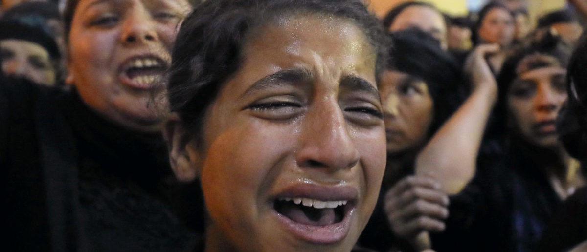 Relatives of victims of an attack that killed Coptic Christians on Friday react at the funeral in Minya, Egypt, May 26, 2017. REUTERS/Mohamed Abd El Ghany