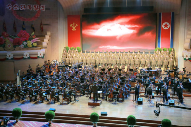 People perform for North Korean leader Kim Jong Un during a celebration for nuclear scientists and engineers who contributed to a hydrogen bomb test, in this undated photo released by North Korea's Korean Central News Agency (KCNA) in Pyongyang on September 10, 2017. KCNA via REUTERS