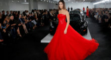 Model Bella Hadid presents a creation from the Ralph Lauren Spring/Summer 2018 collection in a show that was presented in Lauren's private garage for New York Fashion Week in Manhattan, New York, U.S., September 12, 2017.  REUTERS/Andrew Kelly     TPX IMAGES OF THE DAY - RC132970DA00