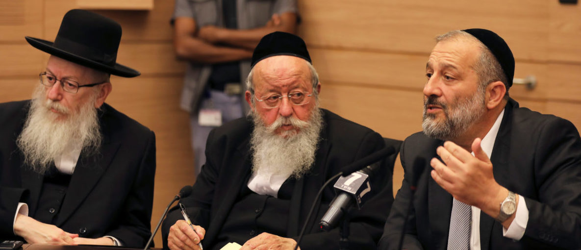 Israel's Interior Minister Aryeh Deri (R) the leader of the ultra-Orthodox Shas party, and Israel's Health Minister, Yaakov Litzman (L) from United Torah Judaism party, attend a meeting at the Knesset, Israel's parliament, in Jerusalem September 13, 2017. REUTERS/Ammar Awad - RC1135F1A130
