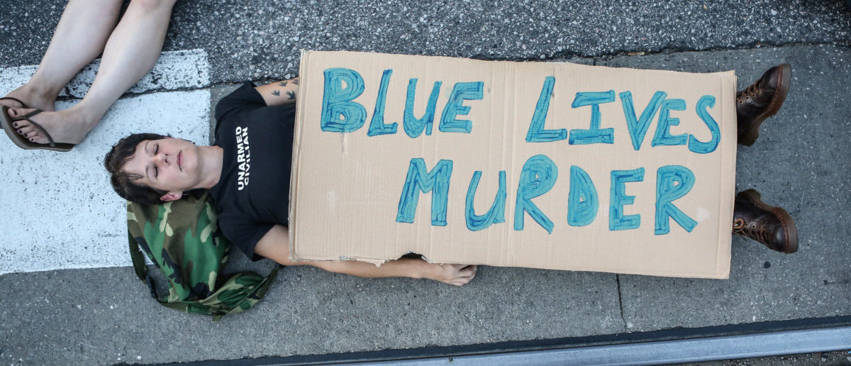"A protester participates in a ""Die-In"" during a second day of demonstrations after a not guilty verdict in the murder trial of former St. Louis police officer Jason Stockley, charged with the 2011 shooting of Anthony Lamar Smith, who was black, in St. Louis, Missouri, U.S., September 16, 2017. Photo taken September 16, 2017. REUTERS/Lawrence Bryant"