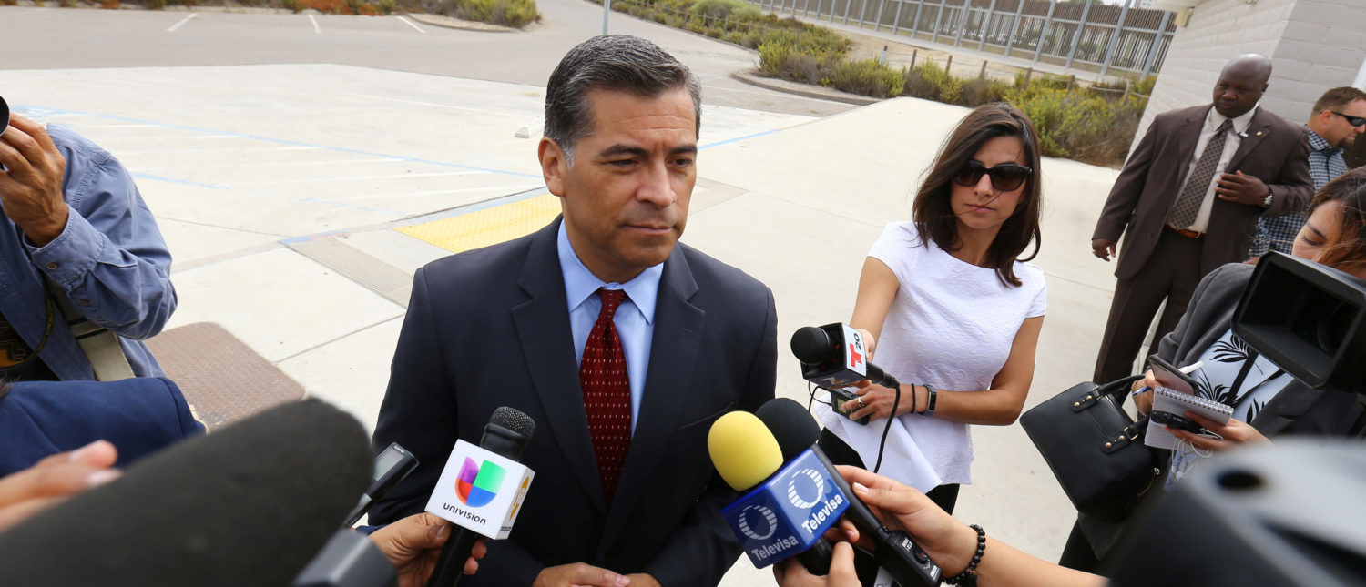 Attorney General of California Xavier Becerra speaks to the media at the U.S.-Mexico border at the Pacific Ocean after announcing a lawsuit against the Trump Administration over its plans to begin construction of border wall in San Diego and Imperial Counties, in San Diego, California, U.S., September 20, 2017. REUTERS/Mike Blake