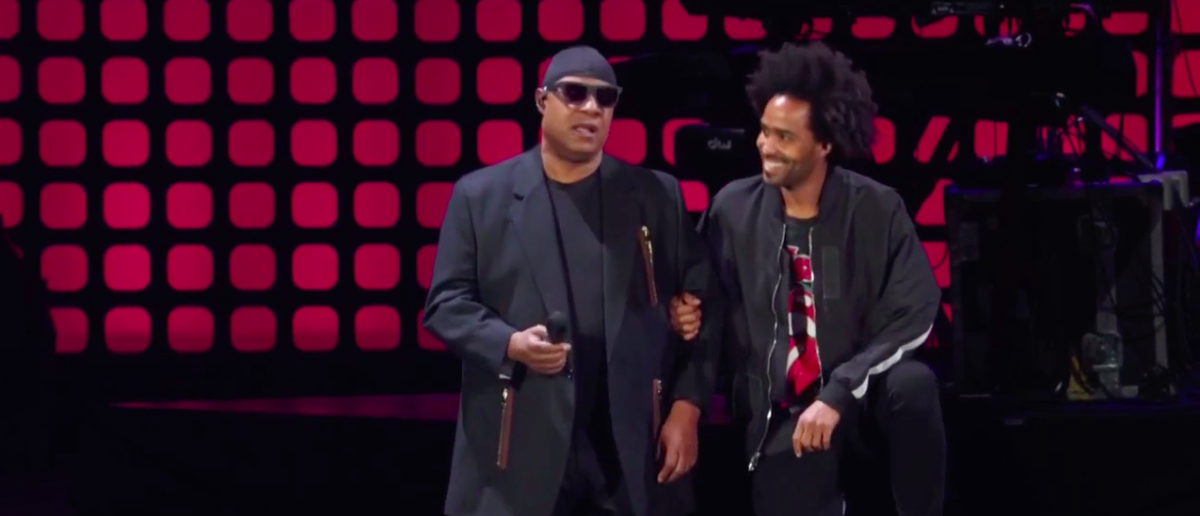 Stevie Wonder Takes Both Knees 'For America' During Charity Concert