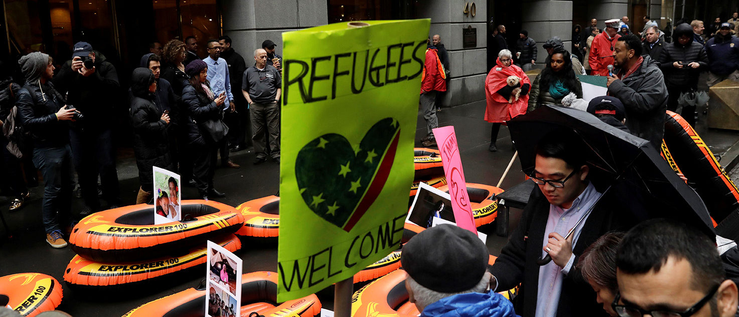 Protesters gather outside the Trump Building at 40 Wall St. to take action against America's refugee ban in New York City, U.S., March 28, 2017. REUTERS/Lucas Jackson
