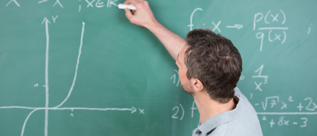 Shutterstock/ Rear view mature male teacher holding paper while writing on chalkboard in classroom  teachermalewritingboardclassroommanbehindformulachalkboardhandcollegepaperblackboardbackcertificatechalkclassdegreediagrameducateeducationequationexplanationgraphhandsomeholdinginformationintelligentknowledgelearninglecturelecturermathematicalmathsnotespresentationprimaryprofessorresearchschoolschoolingscientificsecondarystudyteachingtertiaryuniversitywisdomyoungShow more
