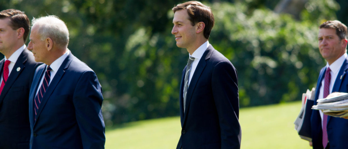 White House aide and Donald Trump's son-in-law, Jared Kushner (center), walks on to the South Lawn of the White House to board Marine One, Friday, August 4, 2017. Michael Candelori (Shutterstock)