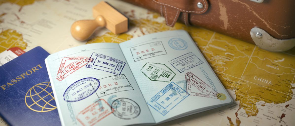 Travel or turism concept. Old suitcase with opened passport with visa stamps. 3d illustration (Maxx-Studio/Shutterstock)