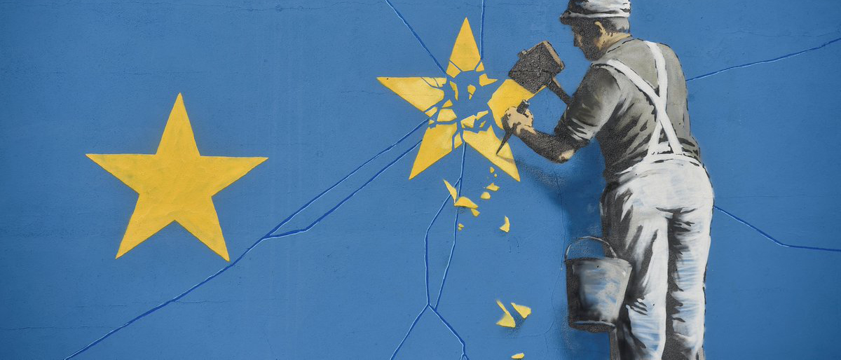 A section of an artwork attributed to street artist Banksy, depicting a workman chipping away at one of the 12 stars on the flag of the European Union, is seen on a wall in the ferry port of Dover, Britain May 7, 2017. REUTERS/Hannah McKay