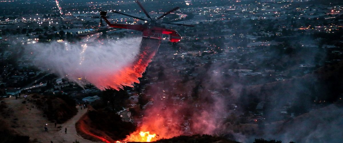 Water is dropped above homes in Sun Valley during the La Tuna Canyon fire over Burbank
