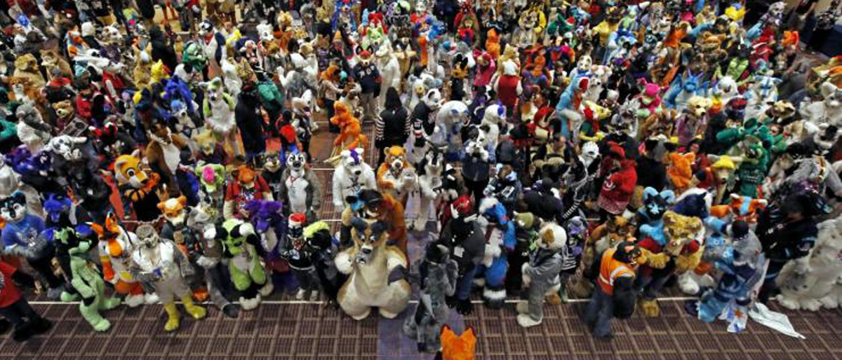 An attendee dress up as a fox moves into position for a group photo at the Midwest FurFest in the Chicago suburb of Rosemont, Illinois, December 5, 2015. REUTERS/Jim Young
