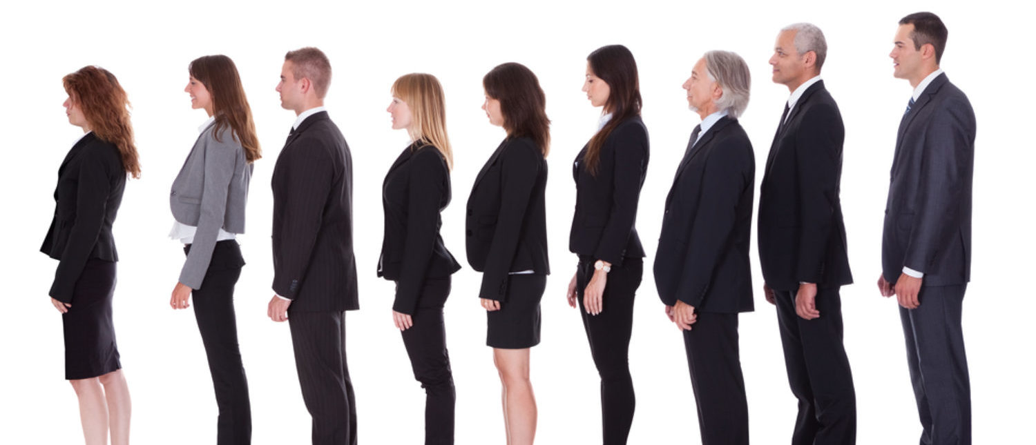 Business professionals lining up for employment. [Shutterstock - Andrey_Popov]