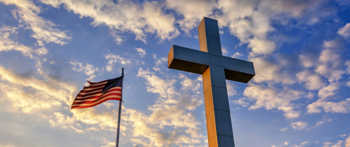 American flag and religious cross at sunset (anthony heflin/shutterstock_357934955)