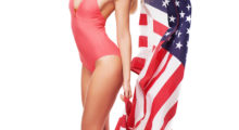 A blonde haired girl in a red one piece is very American. (photo: Shutterstock)