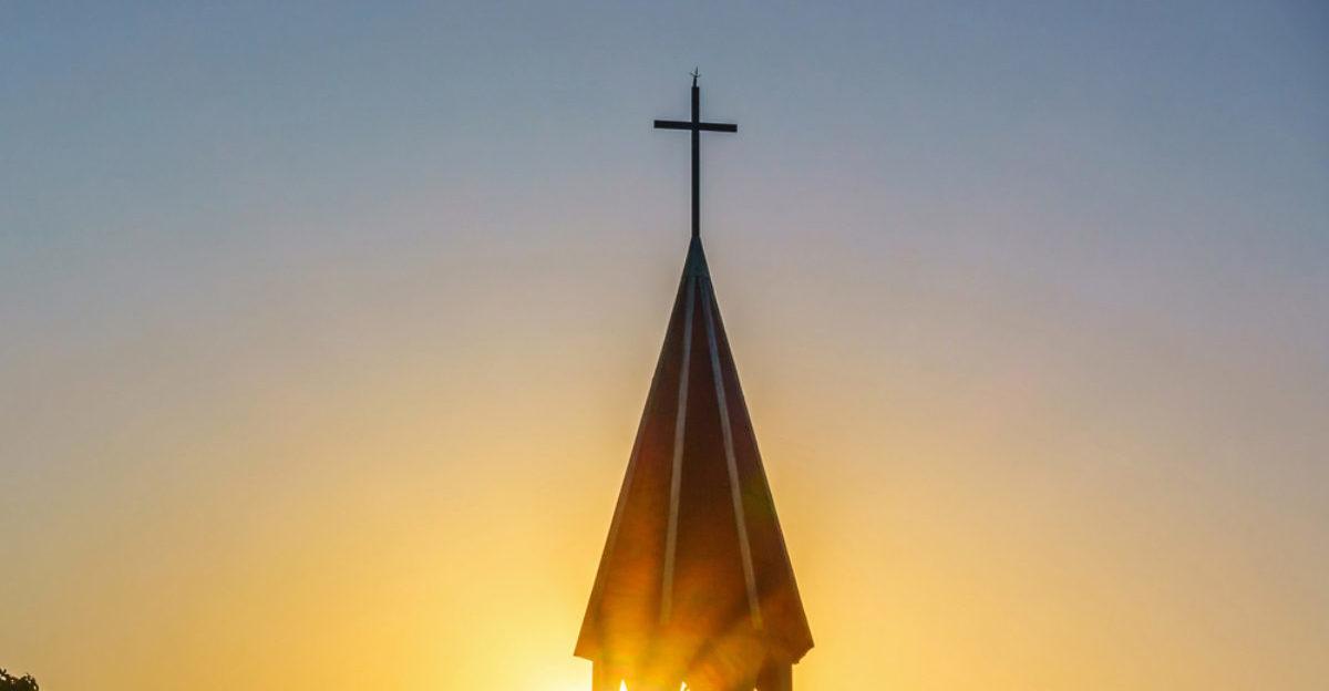 Church steeple with cross (Take Photo/shutterstock)
