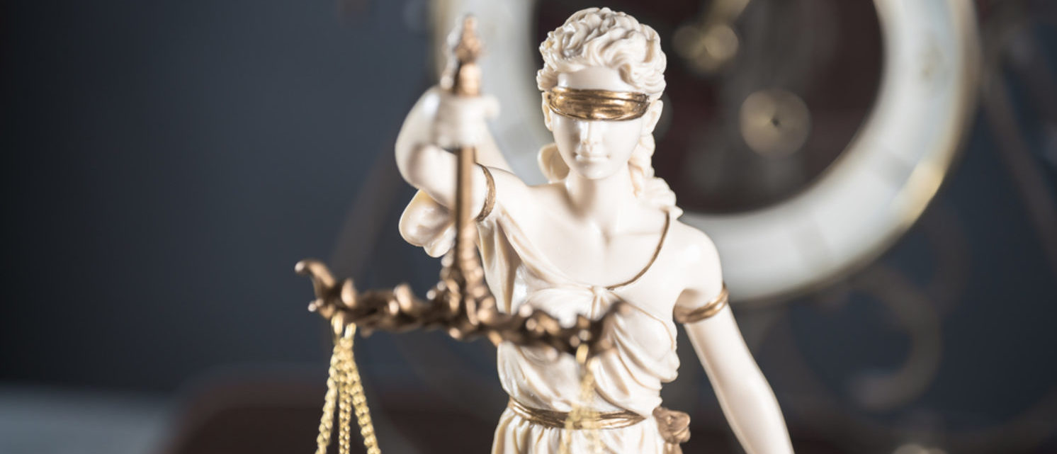 Lady Justice and her scales (Shutterstock/Chodyra Mike)