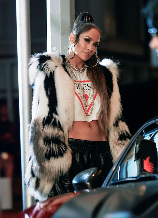 Jennifer Lopez recreates 2002 look in ab-flashing furry outfit and hoop earrings as she joins hunky tattooed co-star on set of new music video for Fiat in NYC. <P> Pictured: Jennifer Lopez <B>Ref: SPL1566787 010917 </B><BR /> Picture by: XactpiX/Splash