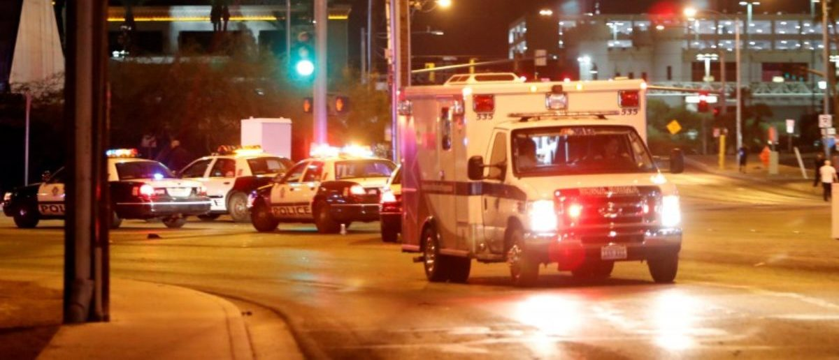 An ambulance leaves the concert venue after a mass shooting at a music festival on the Las Vegas Strip in Las Vegas, Nevada, U.S. October 1, 2017. REUTERS/Las Vegas Sun/Steve Marcus