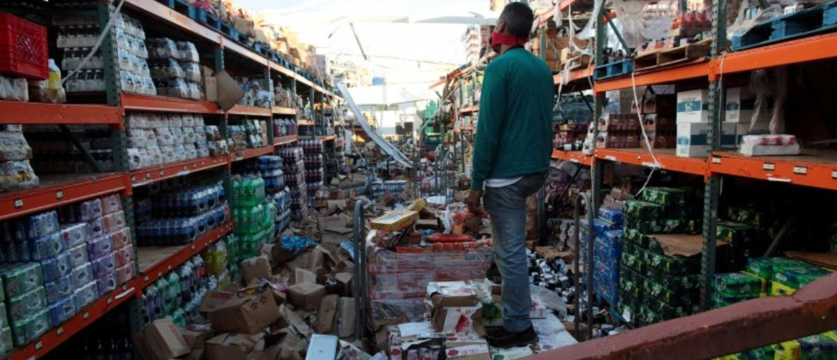 A man stands inside of a destroyed supermarket by Hurricane Maria in Salinas, Puerto Rico