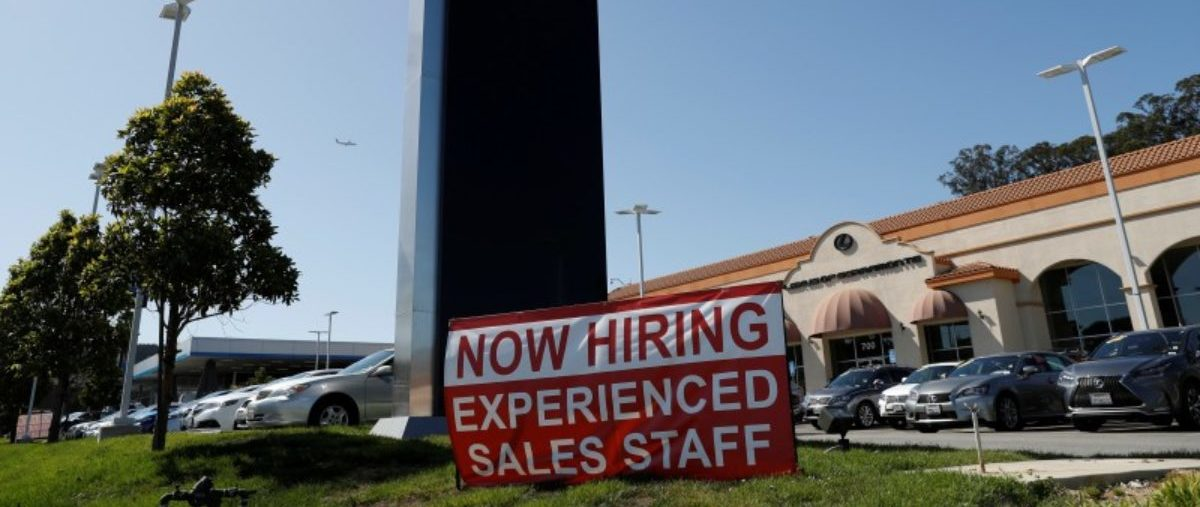 A now hiring sign is seen outside Lexus of Serramonte in Colma, California