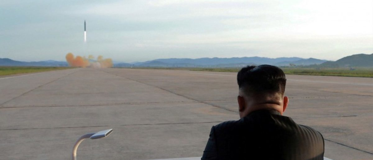 North Korean leader Kim Jong Un watches the launch of a Hwasong-12 missile in this undated photo. KCNA via REUTERS