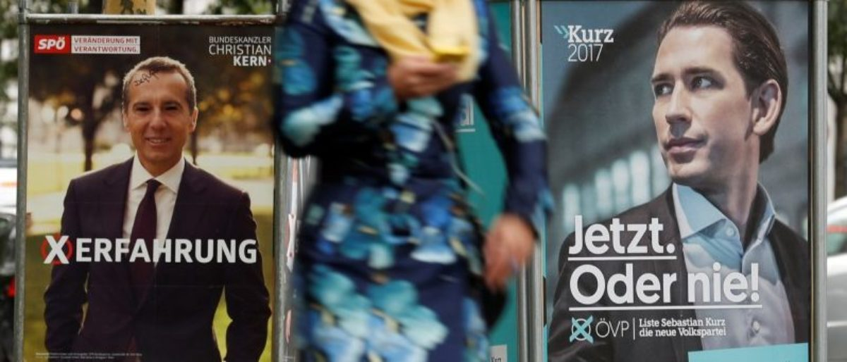 Election campaign posters of the SPOe showing Chancellor Christian Kern and of the OeVP showing Vice Chancellor Sebastian Kurz are seen in Vienna, Austria, October 6, 2017. REUTERS/Heinz-Peter Bader