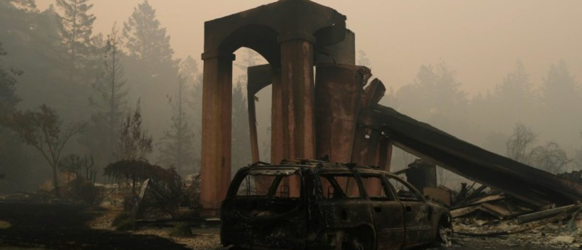 A destroyed home is seen at a residential neighborhood along Fountaingrove Parkway during the Tubbs Fire in Santa Rosa, California