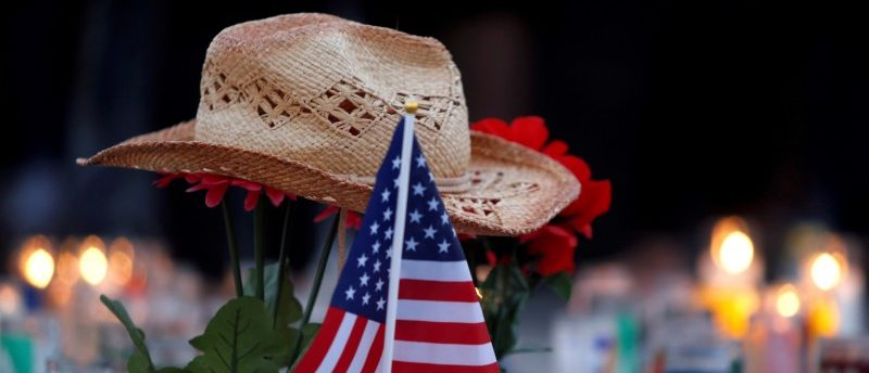 FILE PHOTO - A hat rests on flowers in a makeshift memorial during a vigil marking the one-week anniversary of the October 1 mass shooting in Las Vegas, Nevada U.S. October 8, 2017. REUTERS/Las Vegas Sun/Steve Marcus