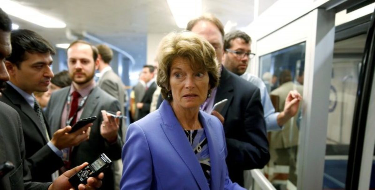FILE PHOTO: Senator Lisa Murkowski (R-AK) speaks to reporters after the Senate approved $15.25 billion in aid for areas affected by Hurricane Harvey along with measures that would fund the federal government and raise its borrowing limit on Capitol Hill in Washington, U.S., September 7, 2017.   REUTERS/Joshua Roberts/File Photo