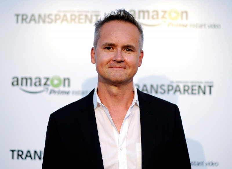 "FILE PHOTO: Roy Price, Director of Amazon Studios, poses during Amazon's premiere screening of the TV series ""Transparent"" at the Ace Hotel in downtown Los Angeles, California, U.S. on September 15, 2014. REUTERS/Kevork Djansezian/File Photo"