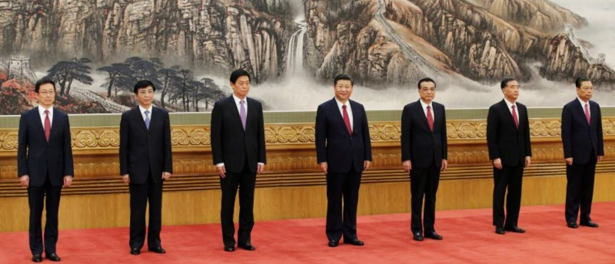 China's new Politburo Standing Committee members (L-R) Han Zheng, Wang Huning, Li Zhanshu, Xi Jinping, Li Keqiang, Wang Yang and Zhao Leji, line up as they meet with the press at the Great Hall of the People in Beijing, China October 25, 2017. REUTERS/Jason Lee