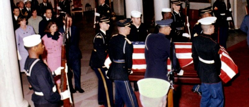 FILE PHOTO: U.S. President John F. Kennedy's widow, first lady Jacqueline Bouvier Kennedy, and his brother U.S. Attorney General Robert F. Kennedy, walk into the White House grand foyer behind his casket upon its return from Dallas to Washington, DC in the early morning hours of November 23, 1963. JFK Library/The White House/Robert Knudsen/File Photo via REUTERS