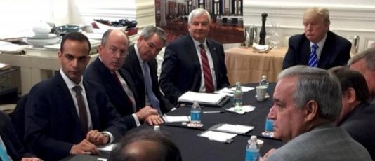 George Papadopoulos (3rd L) appears in a photograph released on Donald Trump's social media accounts with a headline stating that the scene was of his campaign's national security meeting in Washington, D.C. on March 31, 2016 and published April 1, 2016. Social Media/Handout via REUTERS