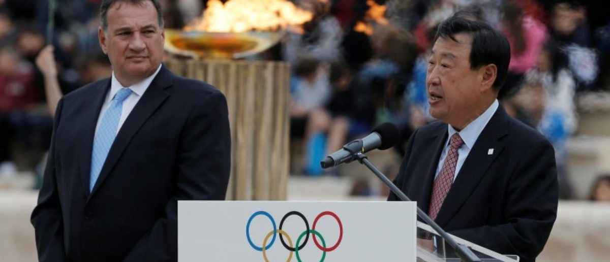 Athletics Olympic - Flame Handover Ceremony For Pyeongchang 2018 Olympics - Panathenaic Stadium, Athens, Greece - October 31, 2017   Lee Hee-beom, president and CEO of the Pyeongchang Organizing Committee for the 2018 Winter Olympic Games makes his address during the handover ceremony as President of the Hellenic Olympic Committee Spyros Capralos looks on   REUTERS/Costas Baltas