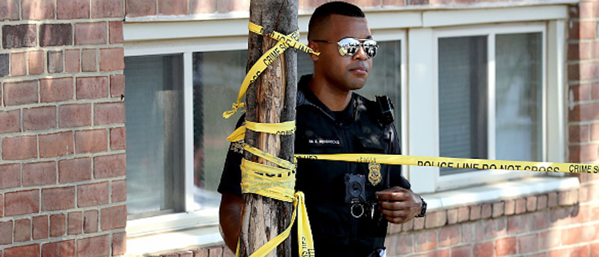 SILVER SPRING, MD - AUGUST 16: A Montgomery County Police officer stands guard as investigators continue their 'brick-by-brick' inspection of the seciton of the Flower Branch Apartments that exploded and burned last week as they continue searching for one last victim August 16, 2016 in Silver Spring, Maryland. Six people ranging in age from 3 to 66 years old are confirmed dead and 30 people were injured when the four-story building exploded last Wednesday night. Investigators have not named a cause for the blast and fire but some residents reported smelling gas before the explosion. (Photo by Chip Somodevilla/Getty Images)