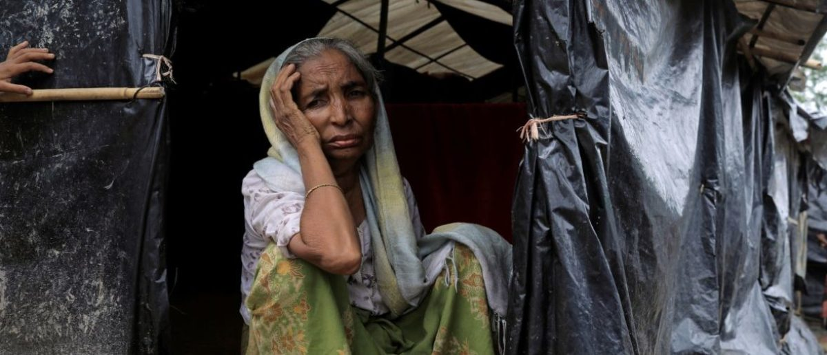 A Rohingya refugee woman sits in her tent in the Kutupalong Refugee Camp in Cox's Bazar, Bangladesh October 12, 2017. REUTERS/Zohra Bensemra