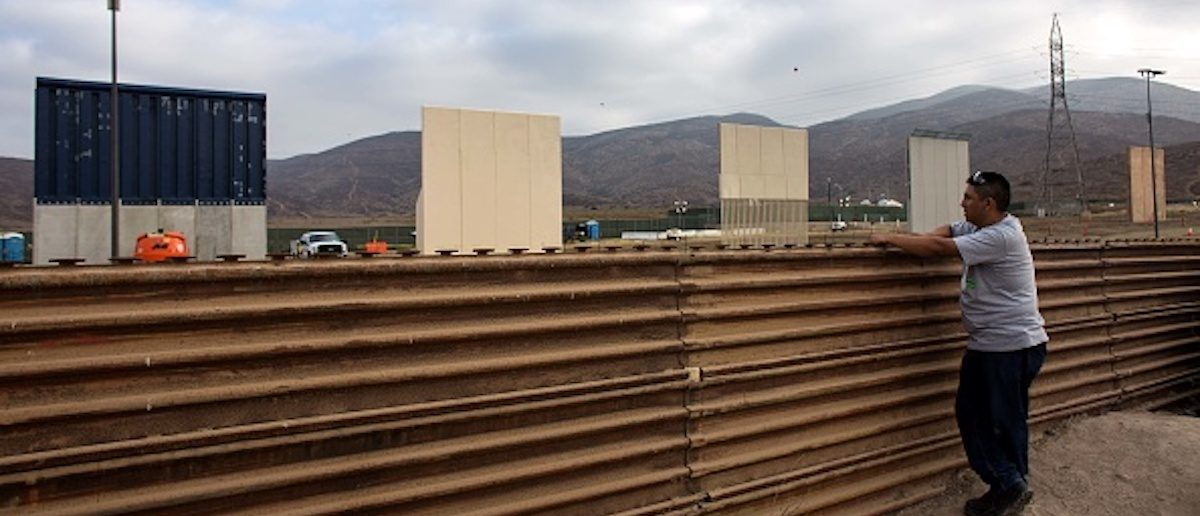 A man watches across the border from Tijuana, Mexico, on October 12, 2017 a prototype of US President Donald Trump's US-Mexico border wall being built near San Diego, in the US,   Following up on President Donald Trump's campaign promise to build a wall along the entire 3,200 kilometre (2,000 mile) Mexican frontier, the Department of Homeland Security began building prototypes for the barrier along the border in San Diego and Imperial counties, as it announced in August.         (Photo: GUILLERMO ARIAS/AFP/Getty Images)