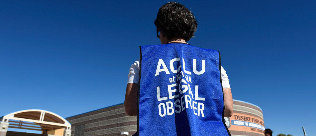 A member of the ACLU observes a polling station during voting in the 2016 presidential election at Desert Pines High School in Las Vegas, Nevada, U.S November 8, 2016. REUTERS/David Becker