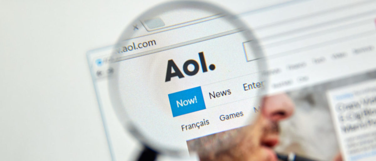 AOL mail and news on the web under magnifying glass. (Shutterstock - dennizn)