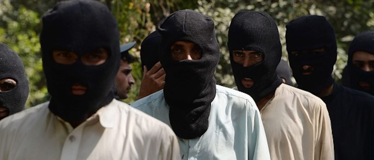 Alleged fighters for the Islamic State and Taliban walk being presented to the media at the police headquarters in Jalalabad on October 3, 2017. (NOORULLAH SHIRZADA/AFP/Getty Images)