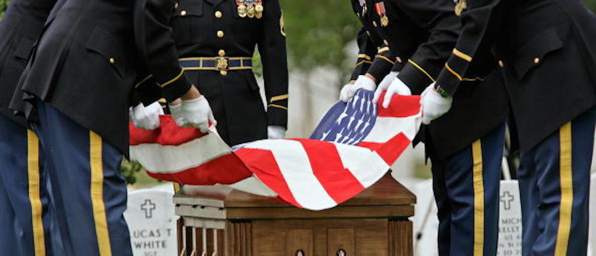 ARLINGTON, VA - JUNE 15: An American flag is lifted from US Army Sgt. Charles Wyckoff's casket during his funeral at Arlington National Cemetery June 15, 2007 in Arlington, Virginia. Sgt. Wyckoff, 28, of Chula Vista, California, died after being shot by small-arms fire in the Afghanistan's Helmand province. Sgt. Wyckoff is the 52nd member of the military killed in Afghanistan to be buried at Arlington National Cemetery. (Photo by Chip Somodevilla/Getty Images)