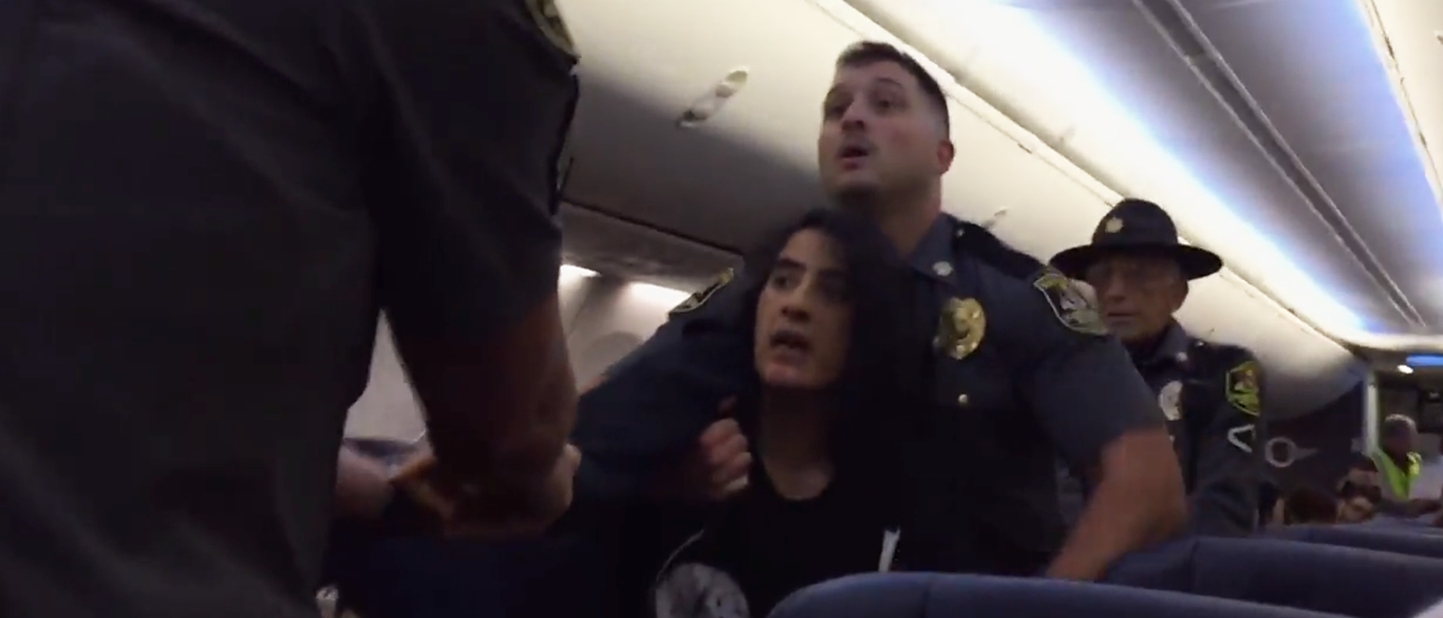 Anila Daulatzai is dragged off a Southwest Airlines flight by Maryland Transportation authority police officers on Sept. 27, 2017. (PHOTO: Screenshot via Washington Post/washingtonpost.com)
