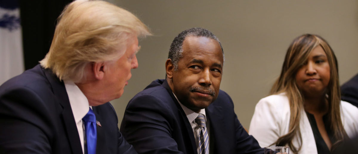 U.S. President Donald Trump attends an African American History Month listening session, accompanied by the Housing and Urban Development Secretary Ben Carson (C) at the Roosevelt room of the White House in Washington U.S., February 1, 2017. (REUTERS/Carlos Barria)