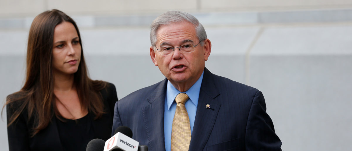 Senator Bob Menendez speaks to journalists after arriving to face trial for federal corruption charges as his daughter Alicia Menendez looks on outside United States District Court for the District of New Jersey in Newark, New Jersey, U.S., September 6, 2017. REUTERS/Joe Penney