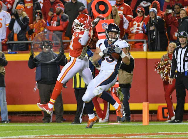 Oct 30, 2017; Kansas City, MO, USA; Denver Broncos tight end A.J. Derby (83) catches a pass for a touchdown as Kansas City Chiefs cornerback Eric Murray (21) defends during the second half at Arrowhead Stadium. Mandatory Credit: Denny Medley-USA TODAY Sports - 10382152