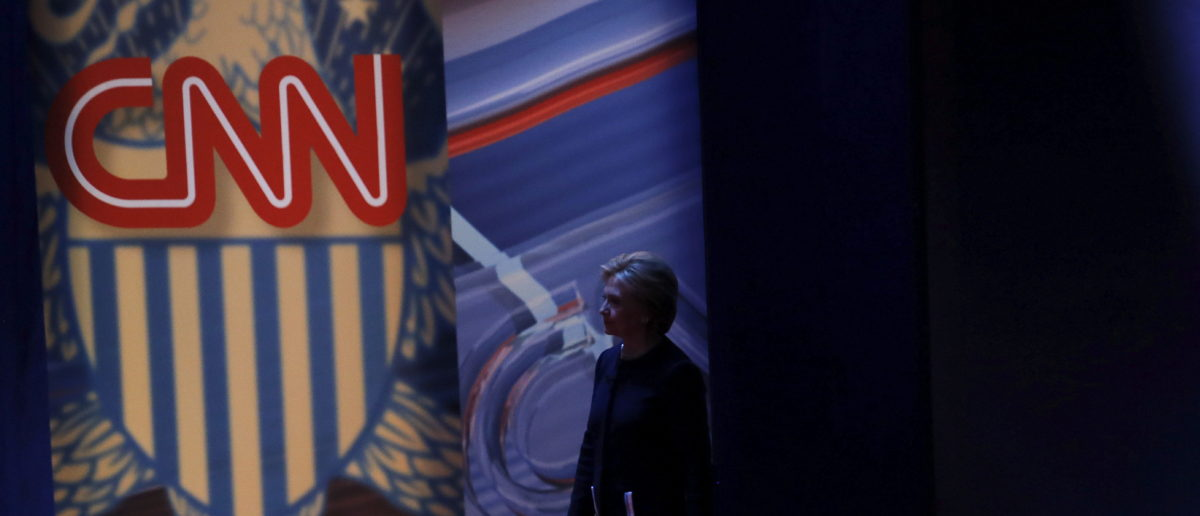 Democratic U.S. Presidential candidate Hillary Clinton returns to the stage after a break during a town hall meeting hosted by CNN in Columbus, Ohio March 13, 2016. REUTERS/Carlos Barria